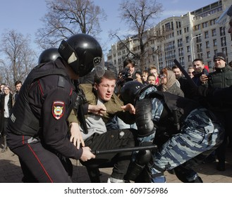 MOSCOW, RUSSIA - MARCH 26, 2017: A man is suffering pain as having been beaten by rubber trancheon at Pushkin Square during mass rally against corruption in Putin's government.