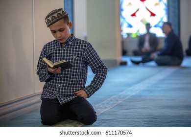Moscow, Russia - March 26, 2017: A participant of children's contest of readers of the Koran is preparing for a contest in the Moscow Cathedral Mosque during the Koran Festival, Russia
