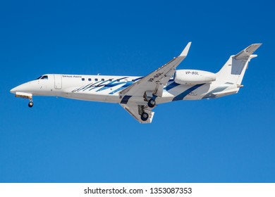 Moscow, Russia - March 26, 2019: Aircraft Embraer EMB-135BJ Legacy VP-BGL of Sirius-Aero against blue sky in sunny morning going to landing at Vnukovo international airport in Moscow