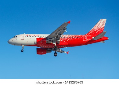 Moscow, Russia - March 26, 2019: Aircraft Airbus A319-111 EI-EYL of Rossiya - Russian Airlines against blue sky in sunny morning going to landing at Vnukovo international airport in Moscow
