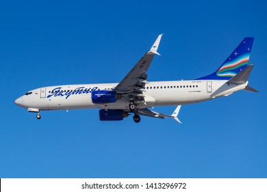 Moscow, Russia - March 26, 2019: Aircraft Boeing 737-86N(WL) VQ-BIZ of Yakutia Airlines against blue sky in sunny morning going to landing at Vnukovo international airport in Moscow