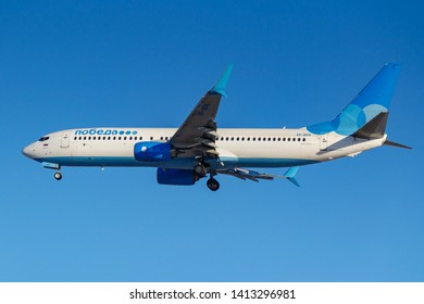 Moscow, Russia - March 26, 2019: Aircraft Boeing 737-800 VP-BPK of Pobeda airline against blue sky in sunny morning going to landing at Vnukovo international airport in Moscow