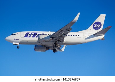 Moscow, Russia - March 26, 2019: Aircraft Boeing 737-500 VP-BFS of UTair Aviation against blue sky in sunny morning going to landing at Vnukovo international airport in Moscow