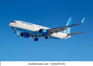 Moscow, Russia - March 26, 2019: Aircraft Boeing 737-8MC(WL) VP-BQB of Pobeda airline against blue sky in sunny morning going to landing at Vnukovo international airport in Moscow