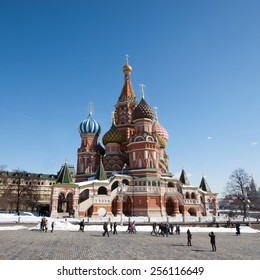 MOSCOW, RUSSIA - MARCH 28, 2013: Tourists walk on the red square. Red square-the Central square of Moscow.