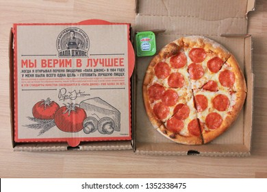 Moscow, Russia - March 28, 2019: Papa John's delivery boxes with pepperoni pizza flat lay top view from above. Papa Johns classic italian pepperoni pizza order in take out paper box isolated