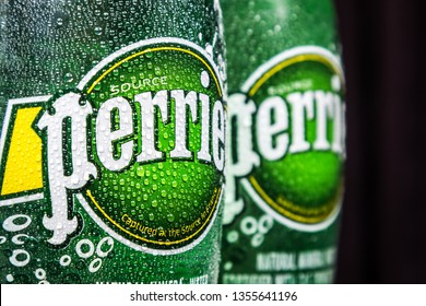 Moscow, Russia - March 28, 2019: logo on mineral water bottles Perrier. Perrier is a French brand of premium mineral water, bottled from springs in the vicinity of verges In the South of France