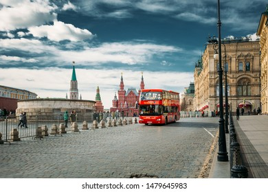 Moscow, Russia - March 28, 2019: Red  Hop On Hop Off Touristic Bus For Sightseeing In old town streets. City Sightseeing Tour. Trip To Famous And Popular Moscow Landmarks.