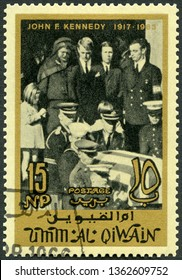 MOSCOW, RUSSIA - MARCH 29, 2019: A stamp printed in Umm al-Quwain shows Kennedy family, memoreal state funeral John F. Kennedy (1917-1963), 1965