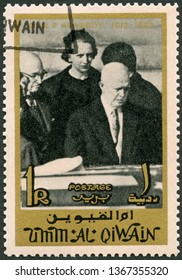 MOSCOW, RUSSIA - MARCH 29, 2019: A stamp printed in Umm al-Quwain shows Dwight D. Eisenhower (1890-1969), memoreal state funeral John F. Kennedy (1917-1963), 1965