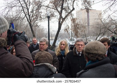 Moscow, Russia - March 3, 2015. The leaders of the party Yabloko Sergei Mitrokhin and Grigory Yavlinsky at the funeral of Boris Nemtsov. Farewell to the oppositionist Boris Nemtsov, who was killed