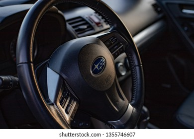 Moscow, Russia - March 30, 2019: Subaru Forester SJ dashboard steering wheel close-up, evening lighting.