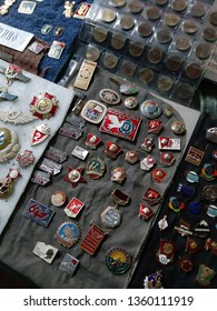 MOSCOW / RUSSIA: MARCH 30 2019 - Vintage metal badges. Museum of industrial culture. Inscriptions: VLKSM,  always, shock worker, festival of youth and students 1978, for solidarity peace and friendshi