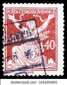 MOSCOW, RUSSIA - MARCH 30, 2019: A stamp printed in Czechoslovakia shows woman breaking chains to Freedom, circa 1920