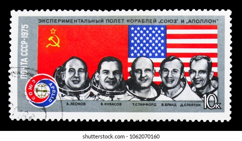 "MOSCOW, RUSSIA - MARCH 31, 2018: A stamp printed in USSR (Russia) shows Cosmonauts: A. Leonov, V. Kubasov, T. Stafford, V. Brand, D. Slayton, Space Flight of ""Soyuz-19"" and ""Apollo"" serie, circa 1975"