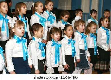 MOSCOW, RUSSIA - March 4, 2009: Children's Choir and Kapellmeister. A music lesson at the municipal school in Moscow.