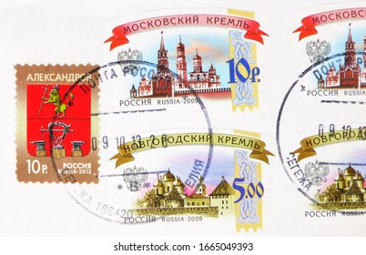 MOSCOW, RUSSIA - MARCH 4, 2020: Postage stamp printed in Russia with stamp of Segezha shows Moscow and Novgorod Kremlins, Coat of arms of Alexandrov city, serie, circa 2009, 2013