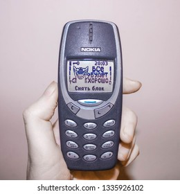 Moscow, Russia - March 5, 2019: A phone in a hand, Nokia 3310 Blue from the year 2000, Nokia is an electronics company.Illustrative editorial image;on the screen:Everything's gonna be alright, unblock