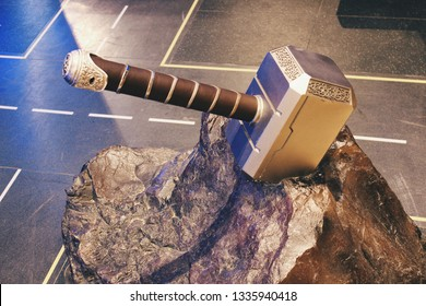 Moscow, Russia - March 5, 2019: Thor's hammer in stone, Thor is a fictional superhero from Marvel Comics; illustrative editorial image on a floor background
