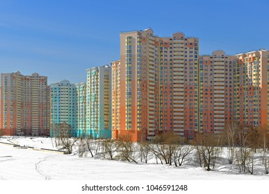 MOSCOW, RUSSIA - MARCH 6, 2018: New buildings on snow-covered embankment of Moscow river against blue sky. Winter landscape