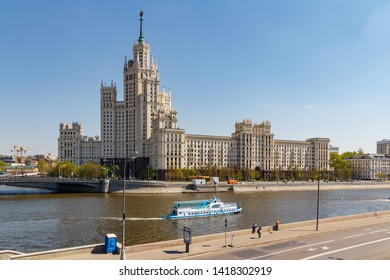 Moscow, Russia - May 01, 2019: Stalin skyscraper on Kotelnicheskaya Embankment in Moscow on a background of Kosmodamianskaya embankment of Moskva river against blue sky at sunny spring morning