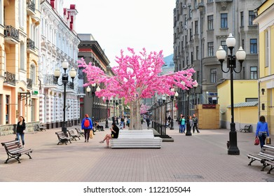 MOSCOW, RUSSIA - MAY 02: People walking by Arbat pedestrian shopping street, Moscow on May 2, 2018. Arbat is the first touristic street in city center of Moscow, Russia.