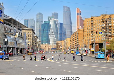 MOSCOW, RUSSIA - MAY 02: People crossing road in Moscow downtown near Moscow city district on May 2, 2018.