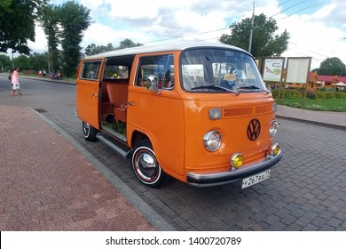 Moscow, Russia - May 03, 2019: Orange classic Volkswagen Transporter T2 (Type 2) retro vehicle parked on the city street with open door