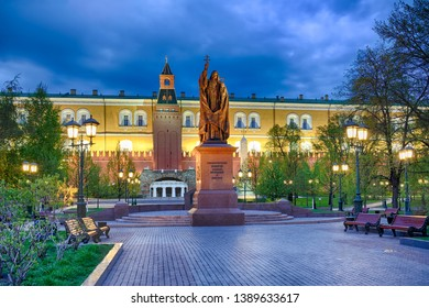 MOSCOW, RUSSIA - May 04, 2019 Monument to Patriarch Hermogenes framed by street lamps in the background of Kremlin wall on the grounds of Alexander Garden in twilight of an early spring morning.