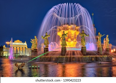 MOSCOW, RUSSIA - May 04, 2019 Illuminated Friendship of Nations fountain at VDNKh park in twilight in a spring evening. The fountain was reopened after comprehensive restoration in April 2019