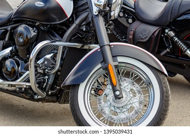 Moscow, Russia - May 04, 2019: Front wheel of matte black Kawasaki Vulcan tourist motorcycle in a parking. Moto festival MosMotoFest 2019