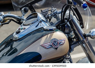 Moscow, Russia - May 04, 2019: Chromed speedometer and ignition switch on the glossy fuel tank of Kawasaki Vulcan tourist motorcycle closeup. Moto festival MosMotoFest 2019