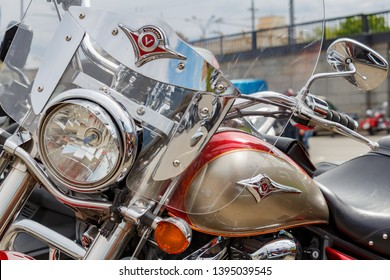 Moscow, Russia - May 04, 2019: Chromed Kawasaki Vulcan tourist motorcycle in a parking closeup at sunny day. Moto festival MosMotoFest 2019