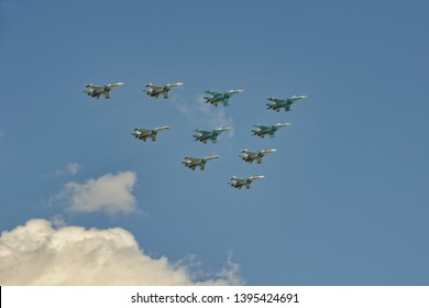 MOSCOW, RUSSIA - May 04, 2019 Tactical Wing of 10 Sukhoi Fighters in blue sky over Red Square during rehearsal of Victory Parade. The Tactical Wing includes Su-35, Su-30SM, and Su-34 airscrafts.