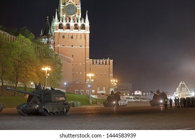 MOSCOW, RUSSIA - MAY 04, 2019: Night rehearsal of the Victory Day celebration (WWII) on Red Square. A column of Russian divisional self-propelled howitzers 2S19 Msta-S leave the Red square
