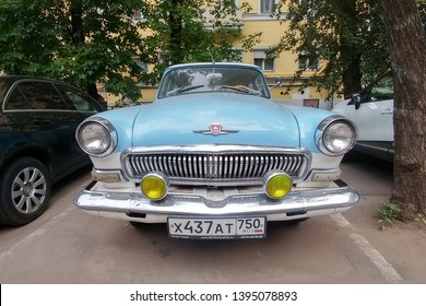Moscow, Russia - May 05, 2019: The rare, restored Soviet car Gas 21 Volga. A blue and white bi-color oldtimer is parked on the street. Front side, headlights