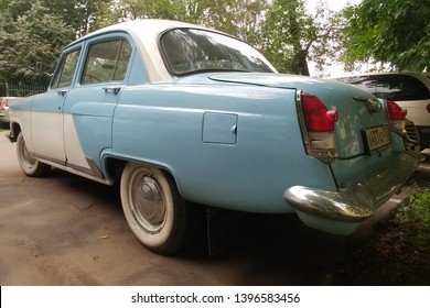 Moscow, Russia - May 05, 2019: The rare, restored Soviet car Gas 21 Volga. A blue and white bi-color oldtimer is parked on the street. Back side view