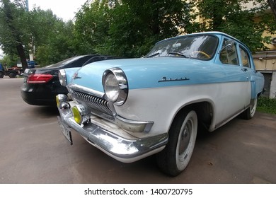 Moscow, Russia - May 05, 2019: The rare, restored Soviet car Gas 21 Volga. A blue and white bi-color oldtimer is parked on the street. Front left side