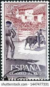 MOSCOW, RUSSIA - MAY 05, 2019: A stamp printed in Spain shows Small town arena, corrida, Fighting with muleta, 1960