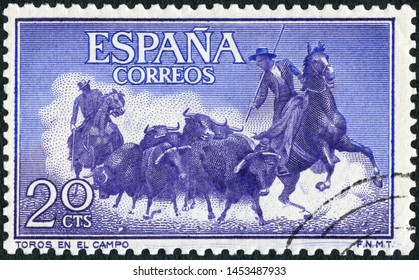 MOSCOW, RUSSIA - MAY 05, 2019: A stamp printed in Spain shows Rounding up bulls, corrida, Fighting with muleta, 1960