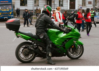 MOSCOW, RUSSIA - MAY 06, 2017: The driver in a helmet and  leather suit on a sports motorcycle against background of buildings, pr. Academician Sakharov. Motofestival 2017