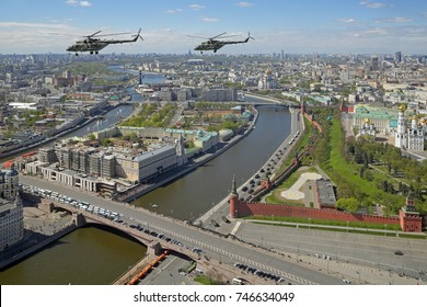 MOSCOW, RUSSIA - MAY 07, 2017: Rehearsal celebration of the 72th anniversary of the Victory Day (WWII) on Red Square. Group of helicopters Mil Mi-8 in the sky over the Bolshoy Moskvoretsky Bridge
