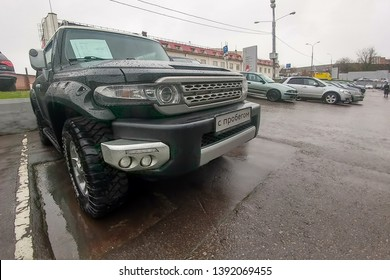 Moscow, Russia - May 07, 2019: A black SUV Toyota FJ Cruiser parked on the street. Front view