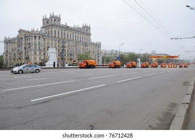 MOSCOW, RUSSIA - MAY 07: Orange street cleansing machines wash the asphalt road before the Victory day military Parade May 07, 2011 in Moscow, Russia.