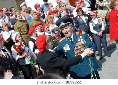 MOSCOW, RUSSIA - MAY 09, 2013: War veterans sing war songs on the Theater Square; by the Bolshoi Theater, traditional place for veterans' meeting.