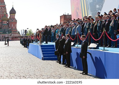 MOSCOW, RUSSIA - MAY 09, 2014: Celebration of the 69th anniversary of the Victory Day on Red Square. The famous Russian policy and leadership of the Ministry of defense of Russia on the VIP tribune