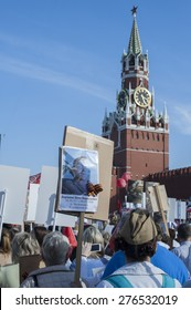 MOSCOW, RUSSIA - MAY 09, 2014:  People with portraits of their relatives during march of 'Immortal Regiment' in Moscow to honor relatives who fought in WWII. The vast column reached Red Square