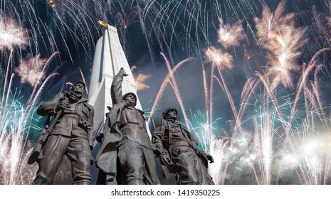 MOSCOW, RUSSIA – MAY 09, 2019: Fireworks over the Monument to countries of anti-Hitler coalition, Alley Partisan in Victory Park on Poklonnaya hill, Moscow, Russia