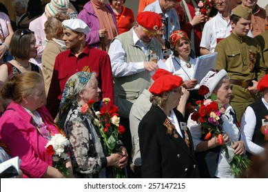 MOSCOW, RUSSIA - MAY 09: War veterans sing war songs on the Theater Square; by the Bolshoi Theater, traditional place for veterans' meeting. Taken on May 09, 2013 in Moscow.