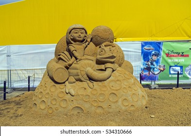 """MOSCOW,  RUSSIA - May 1, 2016: The exhibition of sand sculptures in Kolomenskoye Park. Composition on cartoon """"Miles from Tomorrowland"""" by Dmitry Baklamenko"""